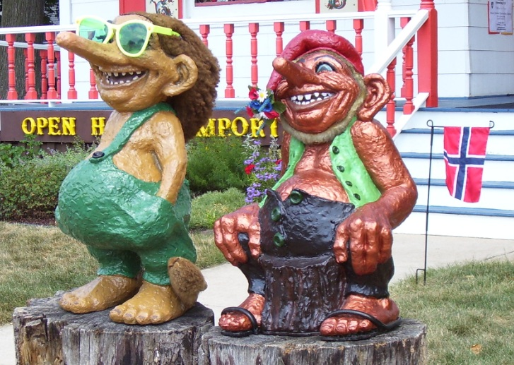Troll Statues In Front Of Open House Imports In Mt. Oreb, Wisconsin