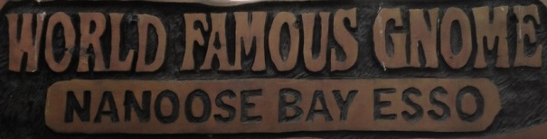 Carved Wood Sign in Front of the World's Largest Gnome in Nanoose Bay, Canada